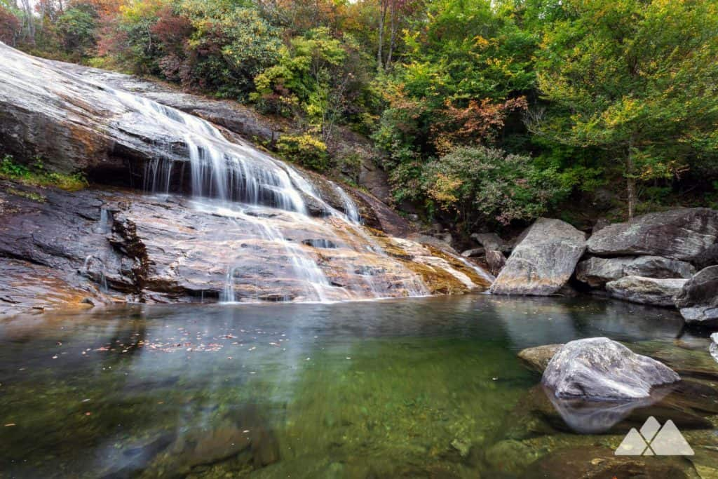 Hike the Graveyard Fields Trail off the Blue Ridge Parkway southwest of Asheville to a duo of waterfalls and through a beautiful, rolling valley