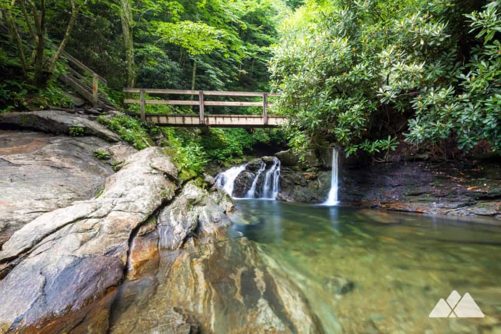 Hike the Skinny Dip Falls Trail to a popular swimming hole and waterfalls near the Blue Ridge Parkway and Graveyard Fields